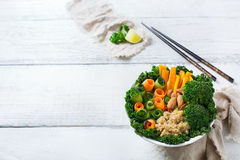 Healthy vegan buddha bowl with kale leaves and raw vegetables Royalty Free Stock Photography
