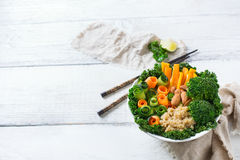 Healthy vegan buddha bowl with kale leaves and raw vegetables Royalty Free Stock Image