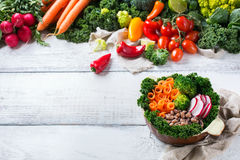 Healthy vegan buddha bowl with kale leaves and raw vegetables Stock Images
