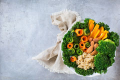 Healthy vegan buddha bowl with kale leaves and raw vegetables Royalty Free Stock Photo