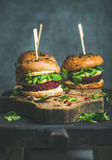 Healthy vegan burger with beetroot-quinoa patty, clean eating concept Stock Images