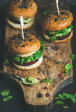 Healthy vegan burger with beetroot-quinoa patty, copy space Royalty Free Stock Photography