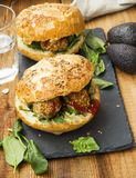 Healthy vegan burgers with chickpea and sesame balls, fresh spin Stock Images