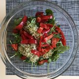 A healthy, vegan, and delicious salad is filled with greens, red pepper, and sprouts. A salad is a dish consisting of a mixture of small pieces of food, usually Stock Image
