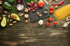 Healthy vegan food cooking ingredients. Flat lay vegetables, fruits, avocados, nuts, mushrooms, onions, green beans and broccoli stock image
