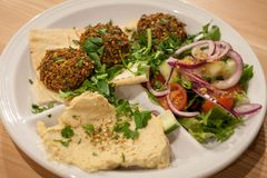 Falafel with salad, hummus and pita bread royalty free stock image