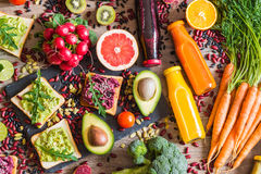 Healthy vegan food. Sandwiches and fresh vegetables on wooden background. Detox diet. Different colorful fresh juices. top view. Healthy vegan food. Fresh stock images
