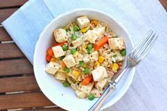 Healthy vegan meal with tofu,peas,carrot,sweet corn and whole grain rice Royalty Free Stock Photography