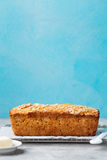 Healthy vegan oat, coconut loaf bread, cake on a cooling rack Grey and blue stone background Stock Photography