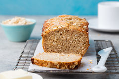 Healthy vegan oat and coconut loaf bread, cake on a cooling rack Stock Images