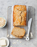 Healthy vegan oat and coconut loaf bread, cake on a cooling rack Top view Royalty Free Stock Images