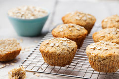 Healthy vegan oat muffins, apple and banana cakes on a cooling rack Stock Photography