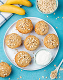 Healthy vegan oat muffins, apple and banana cakes with sour cream Blue stone background Stock Image