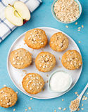 Healthy vegan oat muffins, apple and banana cakes with sour cream Blue stone background Stock Photos