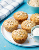 Healthy vegan oat muffins, apple and banana cakes with sour cream on a white plate Royalty Free Stock Photo