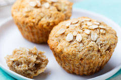 Healthy vegan oat muffins, apple and banana cakes with sour cream on a white plate Royalty Free Stock Images