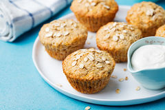 Healthy vegan oat muffins, apple and banana cakes with sour cream on a white plate Stock Photography