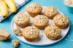 Healthy vegan oat muffins, apple and banana cakes with sour cream on a white plate Royalty Free Stock Photos