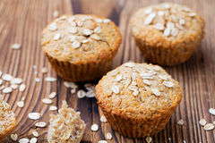 Healthy vegan oat muffins, apple and banana cakes on a wooden background. Royalty Free Stock Photo