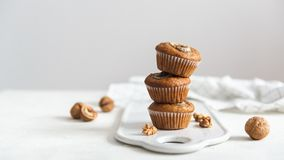Healthy vegan oat muffins, apple and banana cakes on a wooden background. Copy space royalty free stock photography