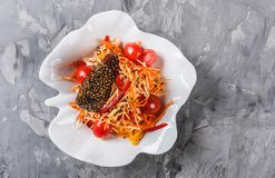 Healthy vegan salad with apple, carrot, cabbage, celery and tomatoes on grey background. Healthy food, clean eating. Top view, flat lay stock photography