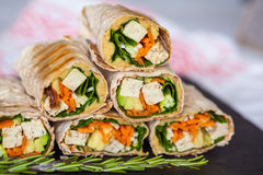 Healthy vegan tofu tortilla wraps with tofu and vegetables Stock Image