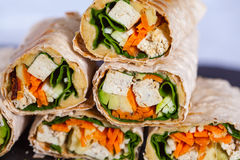 Healthy vegan tofu tortilla wraps with tofu and vegetables Stock Photography