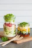 Healthy vegetable cheese salad in mason jars Royalty Free Stock Photo