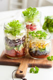 Healthy vegetable cheese salad in mason jars Royalty Free Stock Images