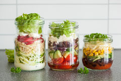 Healthy vegetable cheese salad in mason jars Royalty Free Stock Photos