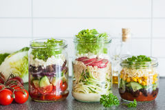 Healthy vegetable cheese salad in mason jars Royalty Free Stock Photo
