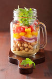 Healthy vegetable chickpea salad in mason jar Stock Images