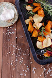Healthy vegetable chips with sea salt, rosemary and garlic on a metal tray on a rustic background. Healthy vegetable beetroot, sweet potato and white sweet stock images