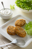 Healthy vegetable cutlets with carrot, dried apricots, almonds and herbs, breaded in oat bran Stock Image