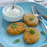 Healthy vegetable cutlets with carrot, dried apricots, almonds and herbs, breaded in oat bran Stock Photography