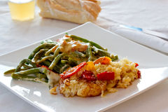Healthy vegetable dinner. A shot of some green beans with melted mozzarella and potato pies stock photography
