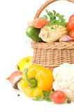 Healthy vegetable food and basket on white Royalty Free Stock Image