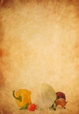 Healthy vegetable food on old paper parchment. Background texture Stock Image