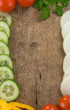 Healthy vegetable food over wood background Stock Photos