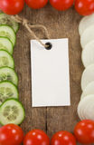 Healthy vegetable food and price tag on wood Stock Images