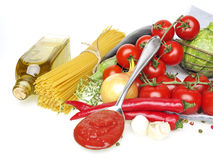 Italian food with vegetable, olive oil, spaghetty and ketchup Royalty Free Stock Photography