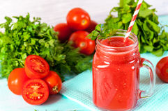 Healthy vegetable. Glass of red tomato juice on a wooden table. Royalty Free Stock Photos