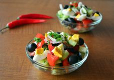 Healthy vegetable salad with eggs in the glass bowl Stock Photos