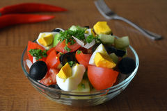Healthy vegetable salad with eggs in the glass bowl Royalty Free Stock Photos