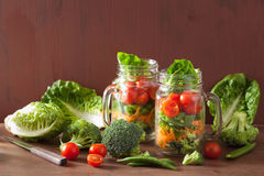 Healthy vegetable salad in mason jar. tomato, broccoli, carrot, Royalty Free Stock Photo