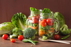 Healthy vegetable salad in mason jar. tomato, broccoli, carrot, Stock Image