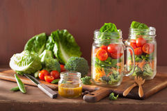 Healthy vegetable salad in mason jar. tomato, broccoli, carrot, Royalty Free Stock Photos