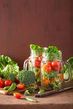 Healthy vegetable salad in mason jar. tomato, broccoli, carrot, Stock Images