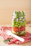Healthy vegetable salad in mason jar: tomato, cucumber, soybean, Stock Images