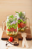 Healthy vegetable salad in mason jar: tomato, cucumber, soybean, Royalty Free Stock Photos